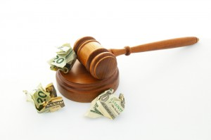 court legal gavel with crumpled cash