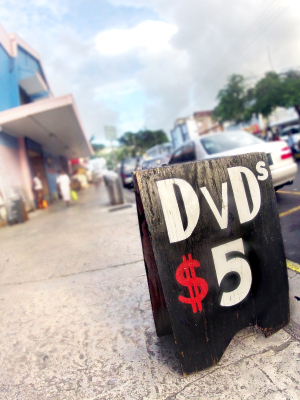 vendor street sign with dvd's on sale